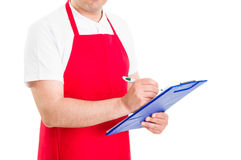 Storekeeper or administrator holding clipboard Royalty Free Stock Photography