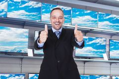Storekeeper gesturing thumb ups Stock Photo