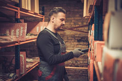 Storekeeper with handheld barcode scanner working in a warehouse Stock Images