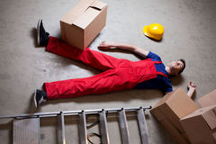 Storekeeper lying on the floor Stock Photo