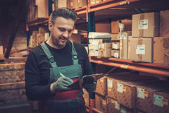 Storekeeper with manual pick list on a warehouse. Storekeeper with manual picking list on a warehouse royalty free stock photo