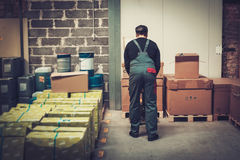 Storekeeper working with pallet truck in a warehouse Royalty Free Stock Photography