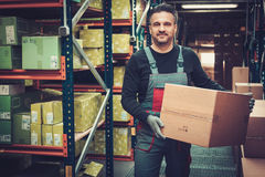 Storekeeper working in a warehouse Stock Photography