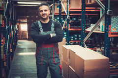 Storekeeper working in a warehouse Royalty Free Stock Image