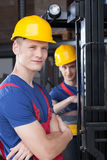 Storekeepers near forklift Royalty Free Stock Image