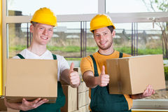 Storekeepers showing thumbs up sign Royalty Free Stock Photography