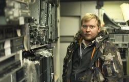 The storeman. Portrait of shelving. The storeman at work. Portrait of shelving. Very cold  weather. Garage Stock Photography