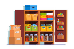 Storeroom or pantry cellar with wooden cupboard. Storeroom interior design with big wooden cupboard full of boxes, glass bottles, household goods. Pantry cellar Royalty Free Stock Images