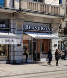 Stores on Bahnhofstrasse street in Zurich. Zurich, Switzerland - 20 April, 2016: people and stores on Bahnhofstrasse street. Bahnhofstrasse is Zurich`s main Royalty Free Stock Images