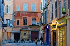 Stores in old town of Aix-en-Provence. AIX-EN-PROVENCE, FRANCE, April 6, 2018 : Old town lies to the north of Cours Mirabeau with irregular streets and old Royalty Free Stock Photography