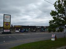 Stores viewed from across the street in Greenfield Park, Longueuil, Quebec, Canada royalty free stock images