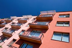 Storey house. With balconies and colorful facade royalty free stock image