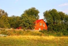 2-storeyed сельский деревянный дом Стоковое Изображение