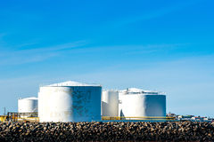 Storgae silos by the ocean Stock Photo