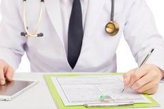 Storia dell'annotazione di medico o forma medica di riempimento Fotografie Stock Libere da Diritti