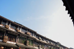 Storied Chinese traditional houses along street in sunny winter Royalty Free Stock Photo