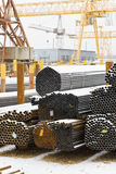 Storing of steel pipes in outdoor warehouse Royalty Free Stock Photo