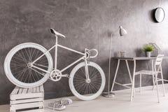 Storing white bike. Classy white bike storing in female minimalist room Stock Photography