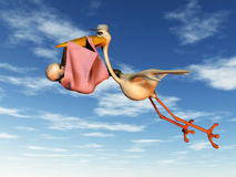Stork with baby. A flying stork holding a baby in a blanket in its beak Stock Image