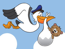 Stork with baby bear. Stork delivering baby bear to new home Stock Photo