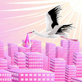 Stork with the baby girl over a city Royalty Free Stock Images