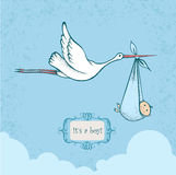 Stork carriyng newborn baby Royalty Free Stock Photo