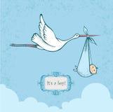 Stork carriyng newborn baby Royalty Free Stock Photo