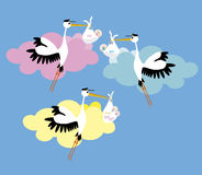 3 Stork delivering a newborn. Stork delivering a newborn boy girl ant twins Royalty Free Stock Photo