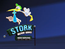 Stork Delivery Neon Sign. Stork Delivery Service Neon Sign Stock Photo