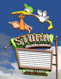 Stork Delivery Service. Stork delivering a baby with a marquee section to personalize Royalty Free Stock Photography