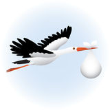 Stork. Flying stork in sky with baby Royalty Free Stock Photos