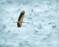 Stork flying in watercolor skies royalty free illustration