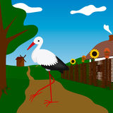 Stork near white house with fence. Stork near white house with brown fence Royalty Free Stock Photo