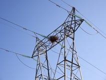 A stork nest on an electricity pylon Royalty Free Stock Image