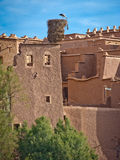 Stork nest on Kasbah,morocco. Stork nesting on top of a  Kasbah in morocco Royalty Free Stock Images