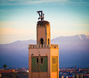 Stork nest on mosque,morocco. Stork nesting on top of a mosque in marakesh in morocco Royalty Free Stock Image