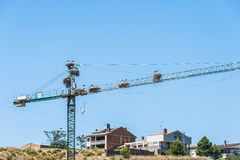 Stork nests on a crane Royalty Free Stock Image