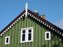 Stork on roof. Old wooden house with stork on roof in Rusne, Lithuania Stock Photos