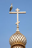 Stork wooden cross Royalty Free Stock Images