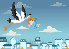 Storken som levererar ett nyfött, behandla som ett barn pojken Arkivbilder