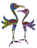 Storks. Two birds in the ethnic style on a white background Royalty Free Stock Photos