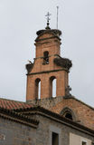 Storks on the bell tower of the church Royalty Free Stock Photography