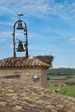 Storks on the bell tower of the church Royalty Free Stock Image