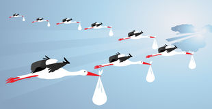 Storks carrying babies Stock Image