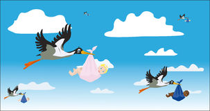 Storks with children Stock Images