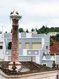 Storks on the nest on a chimney in Silves city Royalty Free Stock Photo