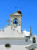 Storks on Tower. Stork nest on top of a bell tower located on Faro, Portugal Stock Image