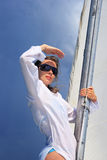 Storm. The girl stand on a yacht nose keeping for a sail during a storm also looks afar Royalty Free Stock Photo