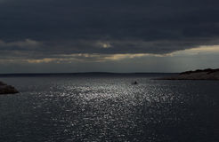 Storm. View of sky and sea few minutes before storm. Boat at horizon Royalty Free Stock Images