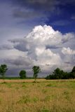 After the storm. Cumulonimbus cloud after a summer storm in Alentejo, Portugal. Vivid saturated colours were used to convey the dramatic feeling of sudden rain Royalty Free Stock Image
